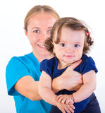Adorable baby and babysitter Royalty Free Stock Photos