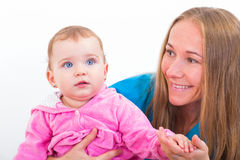 Adorable baby and babysitter. Photo of an adorable baby with her babysitter Royalty Free Stock Photography