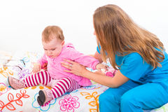 Adorable baby and babysitter Stock Photo