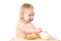 Adorable baby baking bread Royalty Free Stock Photo