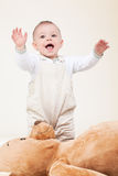 Adorable baby with bear toy Royalty Free Stock Photos