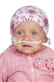 Adorable baby beating the disease Royalty Free Stock Image