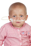Adorable baby beating the disease Stock Photos