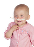 Adorable baby beating the disease Royalty Free Stock Photos