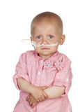 Adorable baby beating the disease Stock Images