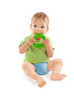 Adorable baby biting a toy isolated on white Royalty Free Stock Photo