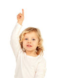 Adorable baby with blond long hair raising the hand. Isolated on a white background Royalty Free Stock Image