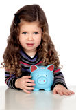 Adorable baby with a blue money-box Royalty Free Stock Photography