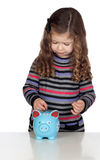 Adorable baby with a blue money-box Royalty Free Stock Images