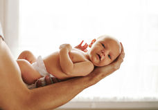 Adorable baby boy being held by his father Stock Photography