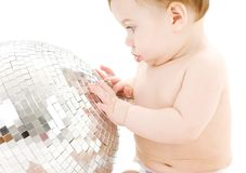 Adorable baby boy with big disco ball Stock Images