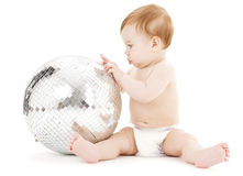 Adorable baby boy with big disco ball Stock Photo