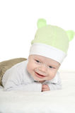 Adorable baby boy  on blanket. In cute clothes on a white background Royalty Free Stock Photos