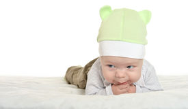 Adorable baby boy  on blanket. In cute clothes on a white background Royalty Free Stock Photo