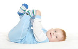 Adorable baby boy on blanket. On a white background Stock Photography