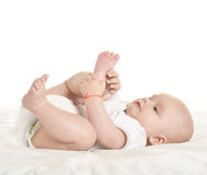 Adorable baby boy   on blanket. On a white background Stock Images