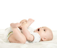 Adorable baby boy   on blanket. On a white background Stock Photos
