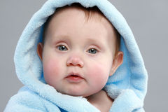 Adorable baby boy in a blue bathrobe Royalty Free Stock Images