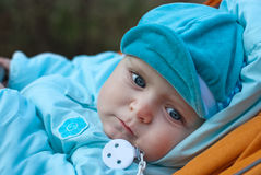 Adorable baby boy in blue clothes Stock Image