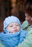 Adorable baby boy bundled up in a shawl Stock Photos