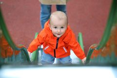 Free Adorable Baby Boy Climbing Up A Slide Royalty Free Stock Image - 148275376