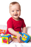 Adorable baby boy with colorful blocks Stock Photography