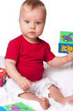 Adorable baby boy with colorful blocks Stock Photo