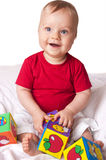 Adorable baby boy with colorful blocks Stock Photos