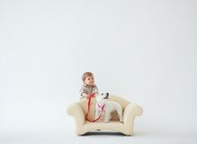 Adorable baby boy with dog. Adorable baby boy with white dog royalty free stock photography