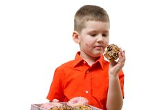 Adorable baby boy eat donut with chocolate. Isolate Stock Photo
