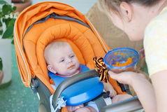 Adorable baby boy first time eating meal Stock Images