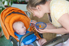 Adorable baby boy first time eating meal Stock Image