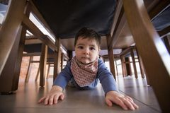 Adorable baby boy funny crawls in the floor stock photography