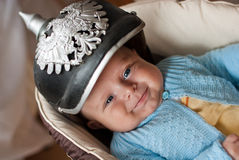 Adorable baby boy in German spicked helmet Royalty Free Stock Images