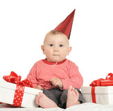 Adorable baby boy with gifts Royalty Free Stock Image