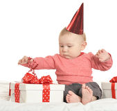 Adorable baby boy with gifts Royalty Free Stock Photo