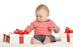 Adorable baby boy with gifts Stock Images