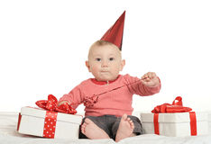 Adorable baby boy with gifts Stock Photos