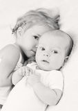 Adorable baby boy and her older sister Royalty Free Stock Photography