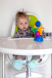 Adorable baby boy in a highchair Royalty Free Stock Photos