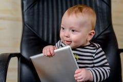 Adorable Baby Boy Holding Tablet Computer Stock Photos