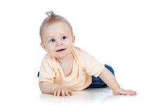 Adorable baby boy lying and smiling Stock Image