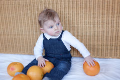 Adorable baby boy with oranges Royalty Free Stock Photo