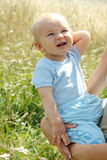 Adorable baby boy outdoors Stock Images