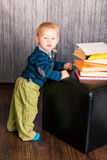Adorable baby boy with a pile of books Stock Photography