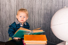 Adorable baby boy with a pile of books Stock Images