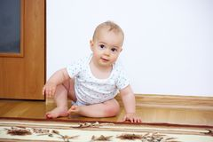 Adorable baby boy playing in badroom in sunny day.  royalty free stock photos