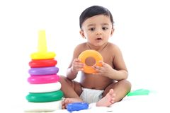 Adorable baby boy playing with stacking rings stock images