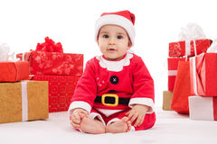 Adorable baby boy in santa claus costume Stock Images
