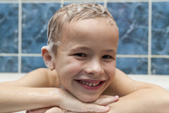 Adorable baby boy with shampoo soap suds on hair taking bath. Cl Stock Photography
